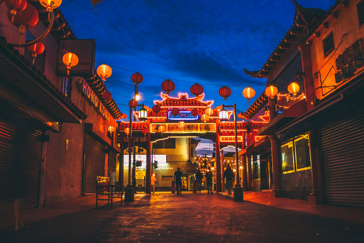 Red Lanterns Architecture Building Building Exterior Built Structure Chinese Lantern City Dusk Group Of People Illuminated Incidental People Lantern Light Lighting Equipment Nature Night Orange Color Outdoors Sky Street Text The Way Forward