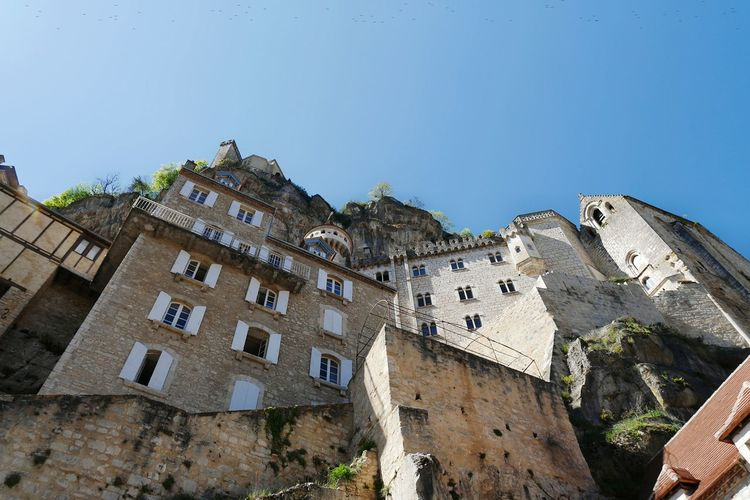 Rocamadour - Architecture Building Exterior Travel Destinations Castle Built Structure Outdoors Sky No People Clear Sky City History Village Streetphotography PlusbeauvillagedeFrance Tourism Old Town Architecturelovers Architectureporn Architecture_collection Old Architecture Architecture Ancient
