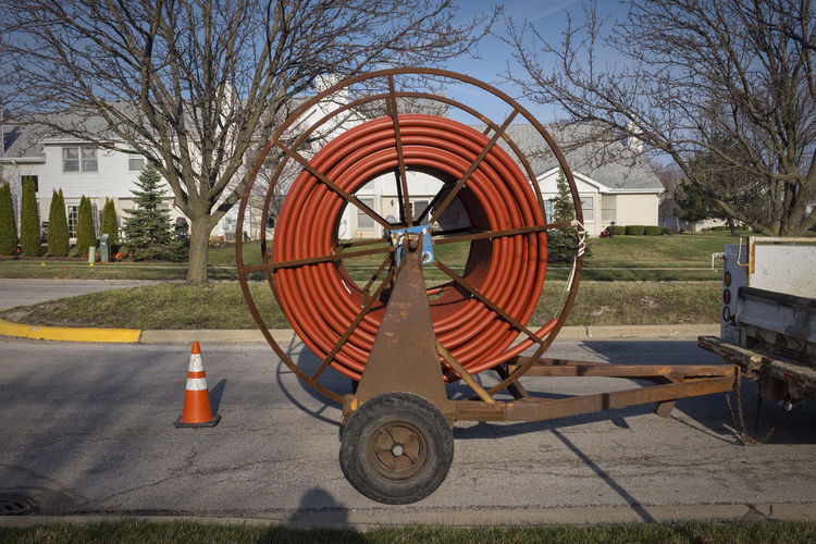 The Need for Speed Bare Tree Cable Circle Day Fiber-optic Grass High-Speed Internet Lawn No People Outdoors Reel Sky Sunlight