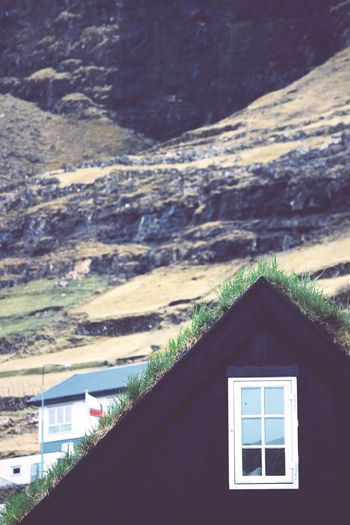House by window on mountain