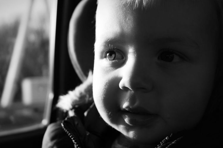 Close-up of thoughtful baby boy looking away