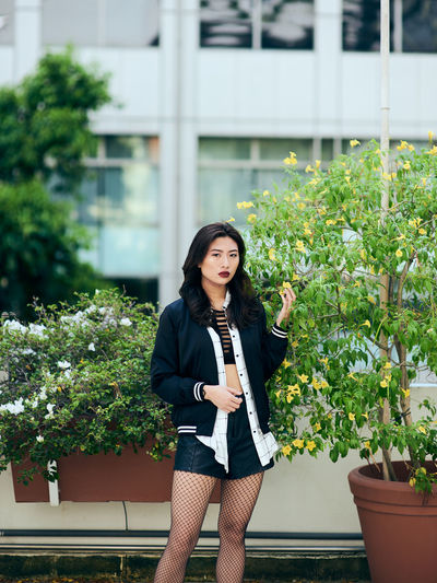 One Person Real People Young Adult Plant Young Women Leisure Activity Three Quarter Length Casual Clothing Lifestyles Building Exterior Standing Portrait Looking At Camera Architecture Built Structure Front View Women Day Growth Outdoors Beautiful Woman Hairstyle Japan Springtime Decadence