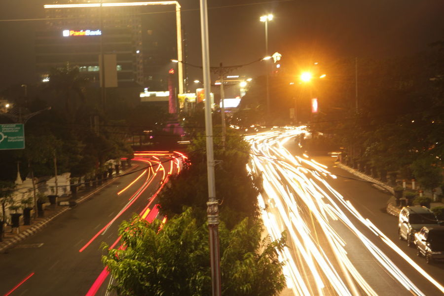 Mobility In Mega Cities Illuminated Night Traffic Road Street Light Street Light Trail City Street Long Exposure Transportation City Life City High Angle View Outdoors Vehicle Light Speed Motion Red