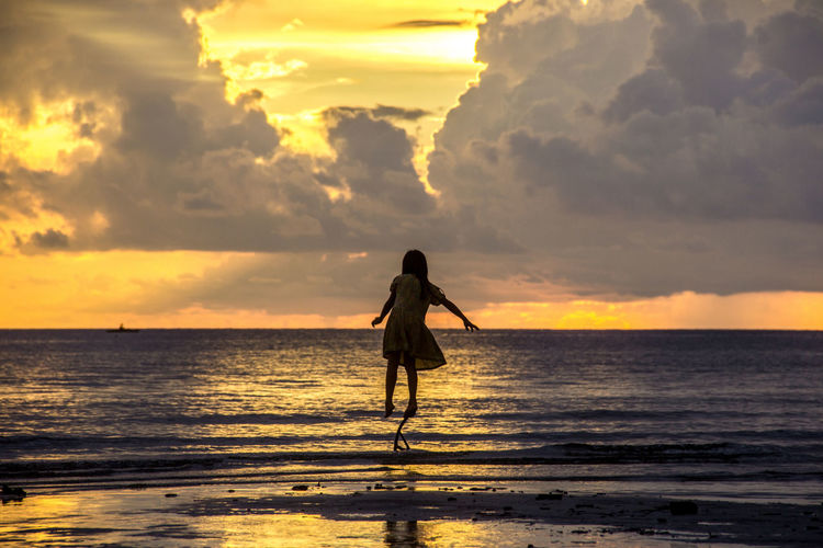 Don't let the fear of falling keep you from flying Sugar Beach Sipalay Beach Beauty In Nature Cloud - Sky Horizon Horizon Over Water Leisure Activity Nature One Person Orange Color Outdoors Scenics - Nature Sea Silhouette Sky Standing Sunset Water