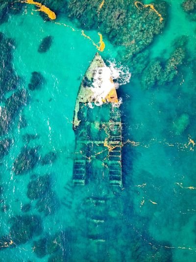 Aerial view of abandoned ship in sea