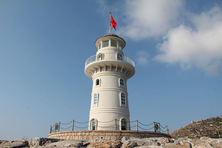 Sky Built Structure Architecture Tower Building Exterior Lighthouse Guidance Low Angle View Protection Security Nature No People Day Building Flag Travel Travel Destinations Safety Direction Blue Outdoors Sea Travel Alanya Turkey