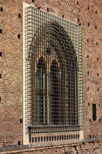 Architecture Built Structure Building Exterior Brick Brick Wall Window Wall Day Building No People Arch Wall - Building Feature Pattern Metal Old Outdoors Low Angle View