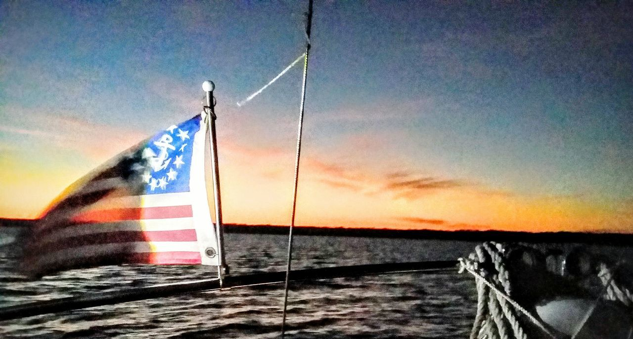 flag, patriotism, water, sea, no people, outdoors, stars and stripes, sky, sunset, nature, day, beauty in nature, close-up