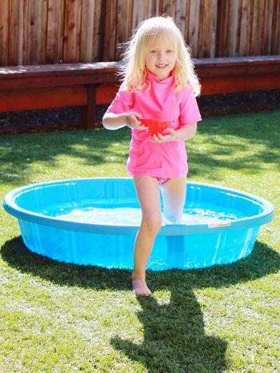 Portrait Of Happy Girl In Tub At Backyard