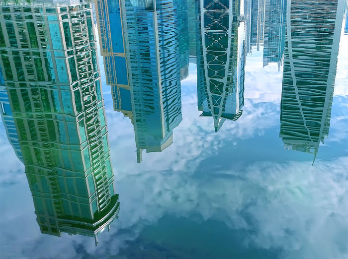 Architecture Blue Building Building Exterior Built Structure City Cityscape Cloud - Sky Day Dubai JLT Jumeirah Lakes Towers Low Angle View Modern Office Building Outdoors Reflection Reflection Sky Skyscraper Tall - High Tower UAE Water Waterfront