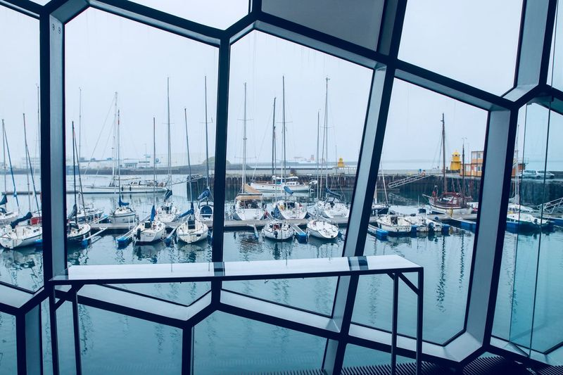 Sailboats in Marina outside Reykjavik's Harpa Concert Hall The Street Photographer - 2018 EyeEm Awards The Traveler - 2018 EyeEm Awards EyeEm Selects Day Built Structure Glass - Material No People Architecture Outdoors Nature Sky Transparent Transportation Window Metal Reflection Mode Of Transportation City Travel Sunlight