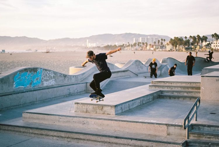 Venice Beach Skateboarding Los Angeles, California Film Photography Leisure Activity Full Length Skateboard Park Mountain Lifestyles Real People Day Jumping Activity Sport Water Outdoors Stunt Sky Architecture Young Adult People Adult EyeEmNewHere