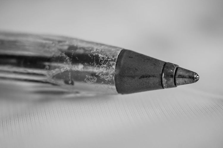 Close-up of ballpoint pen on table