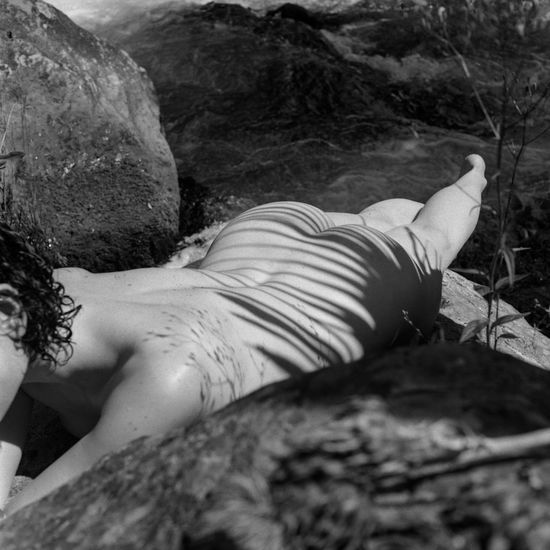 Woman relaxing on rock