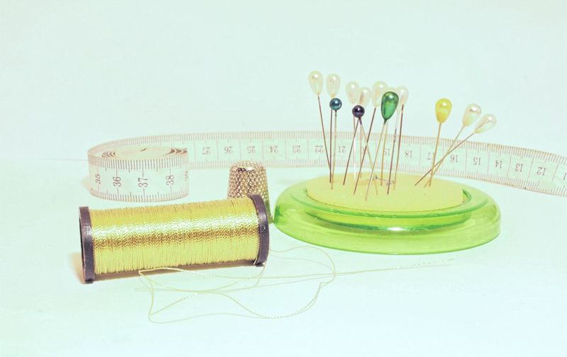 Close-up of sewing kit on white background