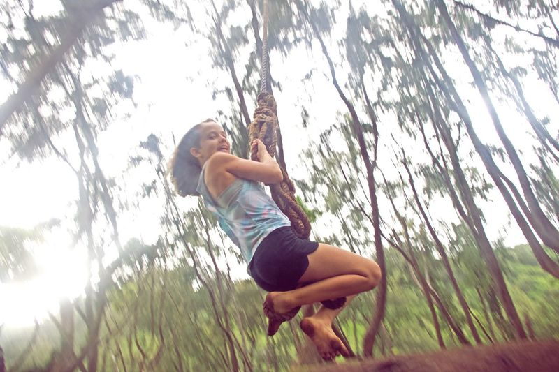 Tree Plant Full Length Low Angle View Leisure Activity One Person Nature Branch Lens Flare Outdoors Real People Sunlight Sky Land Climbing Forest