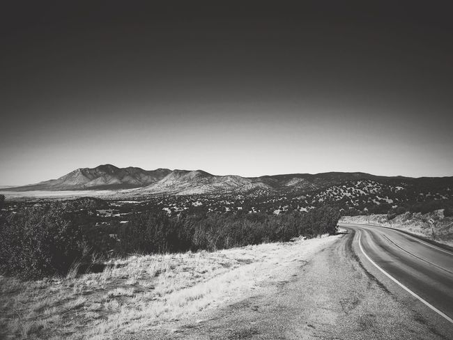 """""""Where The Road Turns"""" New Mexico Photography New Mexico Blackandwhite Photography Black & White Black And White Blackandwhite Highways&Freeways Mountains Travel Roads Transportation No People Outdoors Day Landscape Nature Clear Sky Road Mountain Scenics Beauty In Nature"""