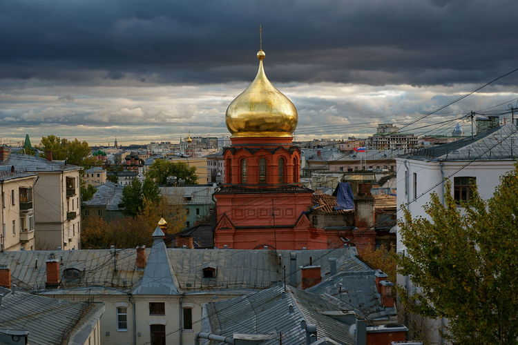 High angle view of buildings at red square against cloudy sky