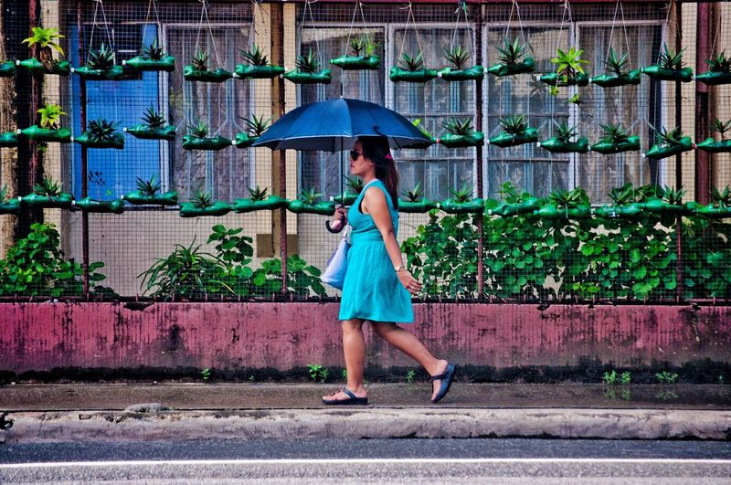 Full Length Outdoors Only Women One Woman Only Green Color One Person Adult Building Exterior Built Structure EyeemPhilippines Rethink Things EyeEm Best Shots Streetphotography