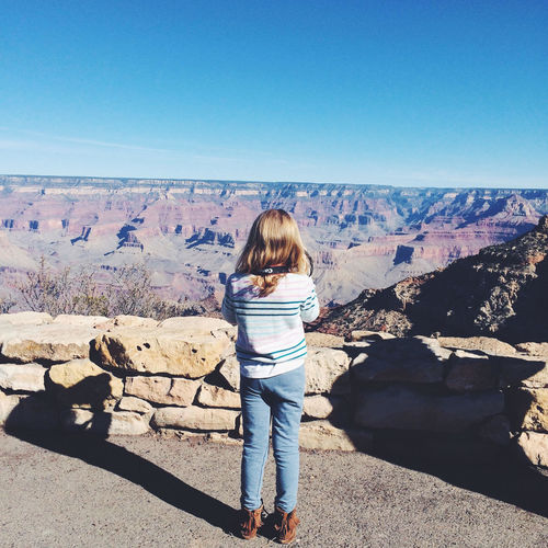 Arizona Beauty In Nature Blue Casual Clothing Child Day Full Length Grand Canyon Kid Landscape Leisure Activity Lifestyles Mountain Nature Outdoors Remote Shadow Sky Sunlight Tourism Tranquil Scene Tranquility Vacations