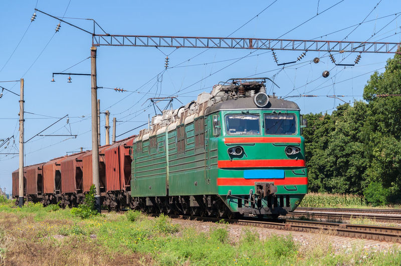 Train on railroad track against clear sky