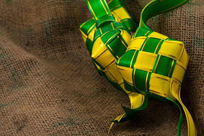 Ketupat is a symbol for Eid Mubarak Close-up Concept Creative Decoration Eid Mubarak Festival Green Color Ketupat No People Ramadan  Raya Ribbon