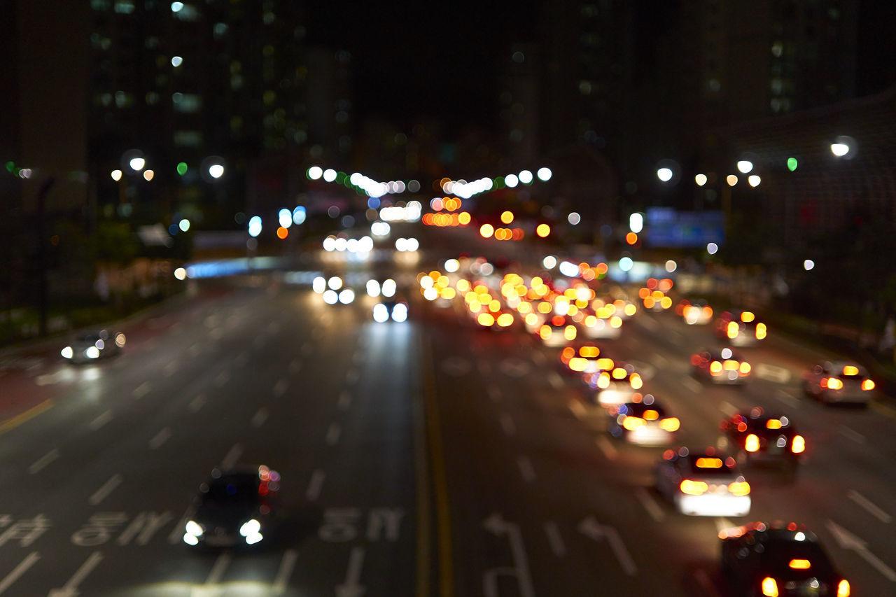 illuminated, night, road, transportation, traffic, street, car, city, outdoors, land vehicle, motion, speed, city life, no people, street light, high street