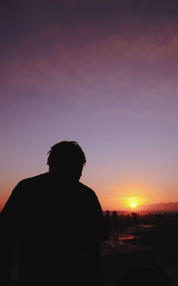 Sunset Silhouette Rear View Real People Sky Beauty In Nature Leisure Activity