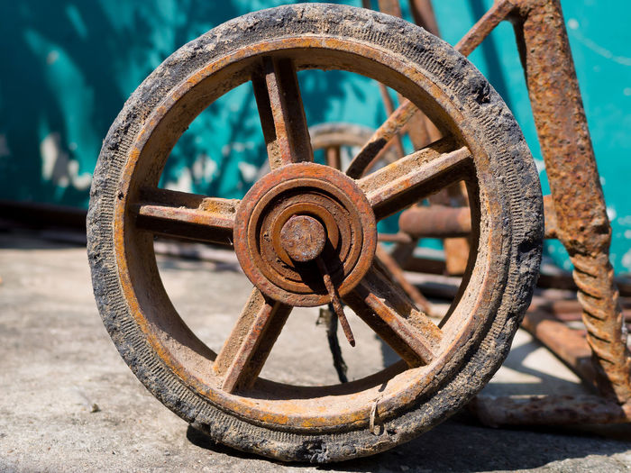 Close-Up Of Rusty Wheel On Street