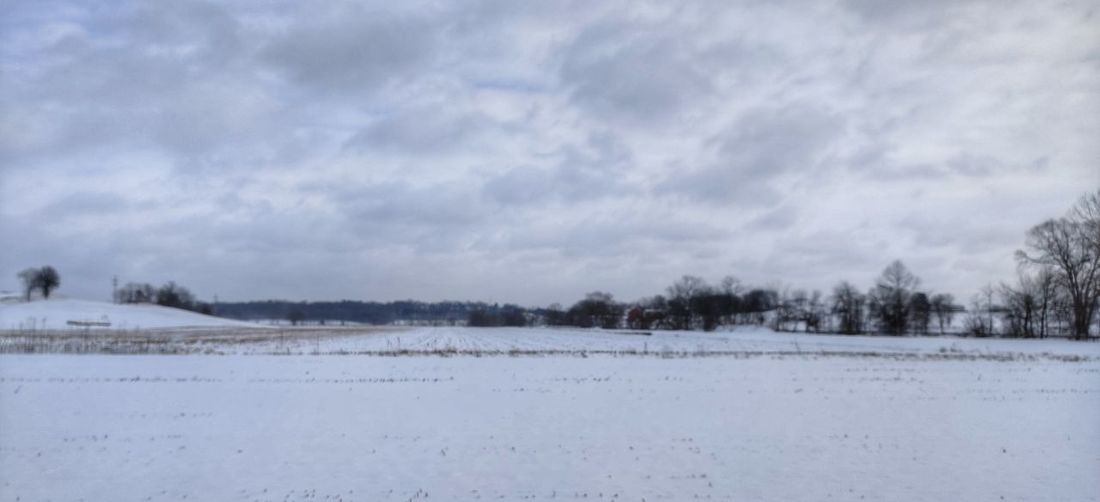 Scenic view of snow field against sky