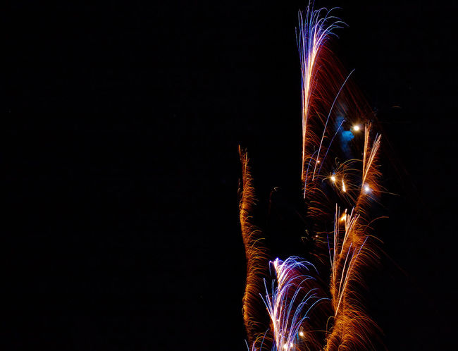 Sylvester 2017/18 Arts Culture And Entertainment Black Background Celebration Event Excitement Firework Firework - Man Made Object Firework Display Illuminated Lifestyles Light Trail Long Exposure Low Angle View Motion Night Nightlife One Person Outdoors People Real People Sky