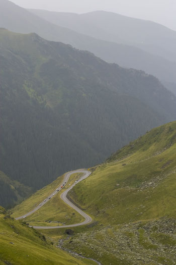 Winding road in valley against mountains