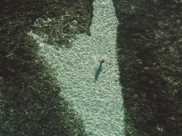 Aerial view of woman standing at beach