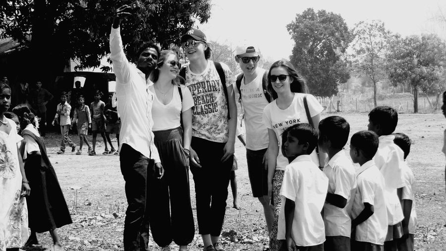 This is the first time these villagers are seeing a white person in their life and are truly amazed by them. They greeted and danced with them and ended up laughing and eating together Celebration Large Group Of People Friendship Togetherness People Guests