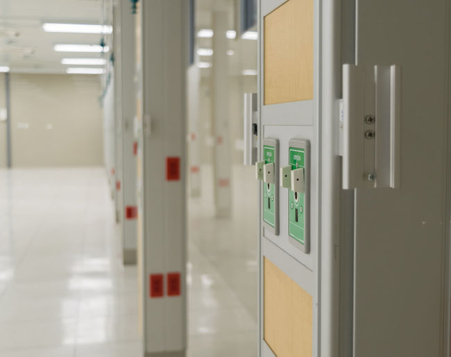 Oxygen Respirator Medical equipment in a hospital Arcade Architecture Automatic Building Built Structure Control Control Panel Corridor Door Entrance Equipment Focus On Foreground Green Color Illuminated Indoors  Medical No People Oxygen Protection Push Button Safety Security Technology Wall - Building Feature