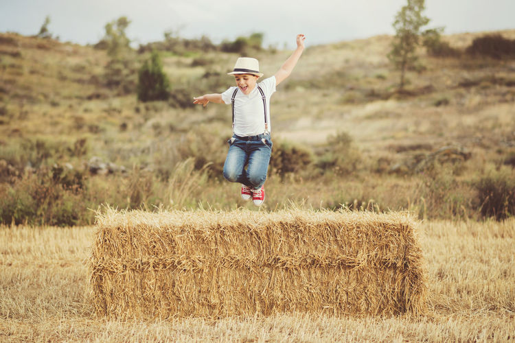 Field Freedom Happy Holidays Jump Lifestyle Sunlight Child Childhood Fun Happiness Jumping Nature Outdoors Playful Smile Smiling Straw Summer