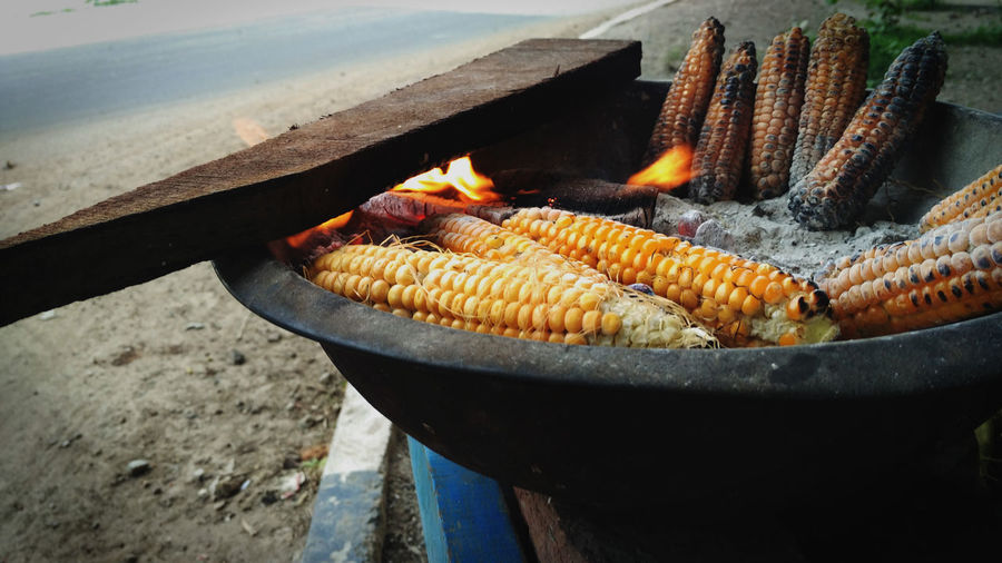roasted corn Barbecue Burning Close-up Corn Corn On The Cob Day Fire Fire - Natural Phenomenon Flame Food Food And Drink Freshness Healthy Eating Heat - Temperature Nature No People Outdoors Preparation  Preparing Food Sweetcorn Vegetable Wellbeing