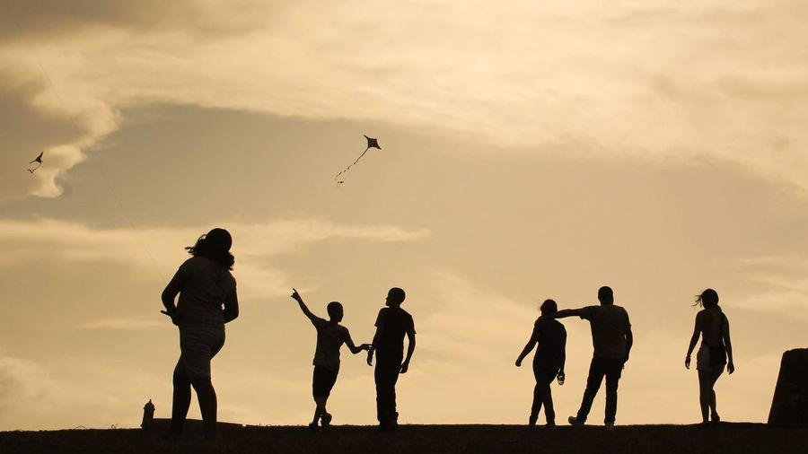 Silhouette Lifestyles Leisure Activity Real People Sunset Flying Vacations Togetherness Outdoors Nature Full Length Beauty In Nature Day People Live For The Story BYOPaper! The Street Photographer - 2017 EyeEm Awards The Great Outdoors - 2017 EyeEm Awards Kite Let's Go. Together. 100 Days Of Summer Investing In Quality Of Life Mix Yourself A Good Time Second Acts EyeEm Ready   An Eye For Travel Colour Your Horizn Press For Progress This Is Family Visual Creativity This Is Latin America Adventures In The City Focus On The Story #urbanana: The Urban Playground Summer In The City A New Beginning 50 Ways Of Seeing: Gratitude A New Perspective On Life Human Connection My Best Photo Streetwise Photography