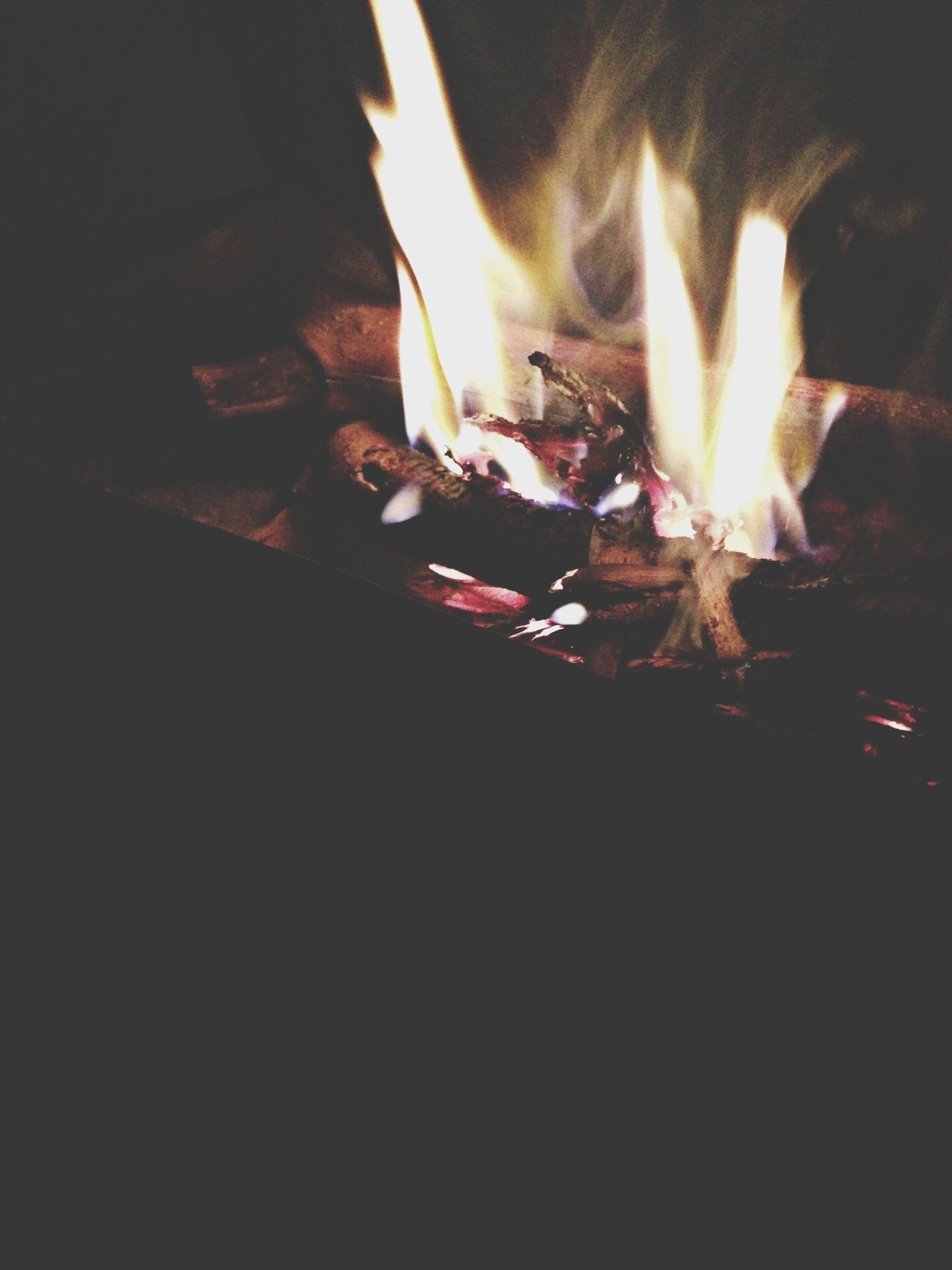 burning, flame, fire - natural phenomenon, heat - temperature, night, glowing, illuminated, fire, bonfire, dark, light - natural phenomenon, close-up, lit, motion, firewood, no people, indoors, heat, candle, orange color
