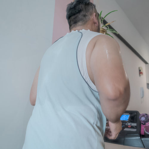 Rear view of man standing at home