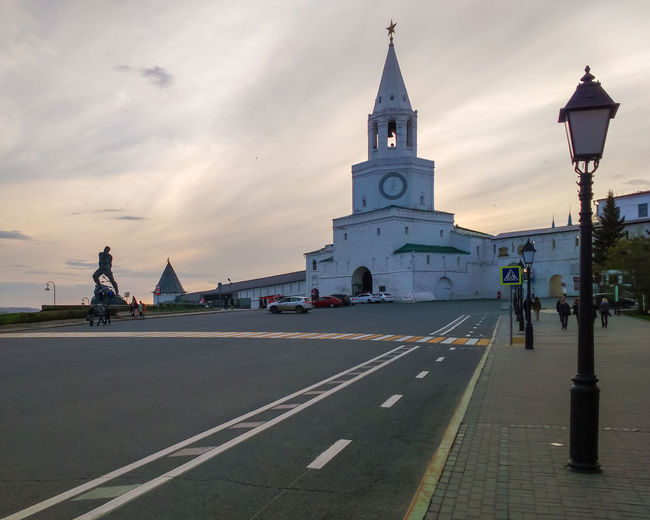The Spasskaya Tower and Monument to Musa Jalil Soccer World Cup Kazan Kremlin Kazan Lanterns Monument To Musa Jalil Russia The Spasskaya Tower Architecture Building Exterior Built Structure City Clouds Evening Outdoors Road Sky Street Symbol Tower