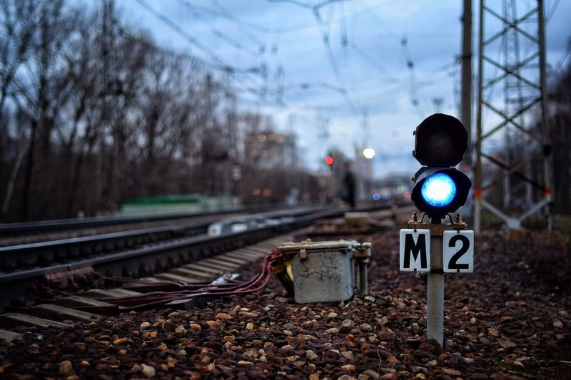 Railroad Signal By Tracks Against Sky