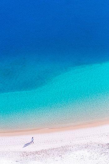 Aerial View Of People Walking On Beach