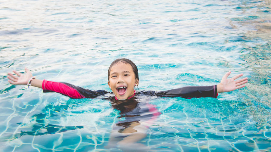 happy time swimming Cheerful Childhood Day Enjoyment Excitement Floating On Water Fun Happiness Leisure Activity Lifestyles Looking At Camera Nature One Person Outdoors People Portrait Real People Smiling Swimming Swimming Pool Vacations Water Waterfront Young Adult Young Women