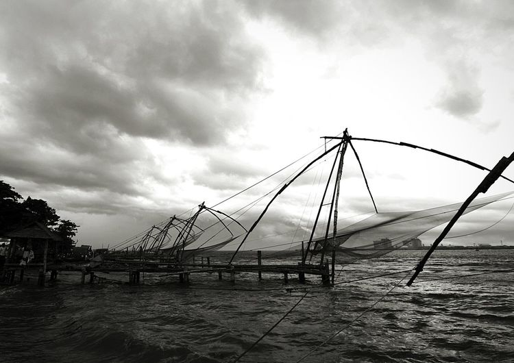 Chineese Fishing Nets are still used in Cochin , Kerala. These nets are brougt to Kerala by Chineese traders many years ago. Water Storm Cloud Sea Storm No People Outdoors Nature Sky Blackandwhite Black And White Photography Black & White Photography Black&white Black And White Collection