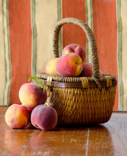 sweet Michigan peaches in a wicker basket Agriculture Fall Colors Freshness Nature USA Basket Close-up Container Food Food And Drink Freshness Fruit Healthy Eating Indoors  Juicy Fruit Michigan Peaches Orange Color Organic Peanuts Peach Still Life Table Wellbeing Wicker Wood - Material Yellow
