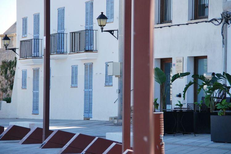Street Lamps Blue Windows Plants Eivissa Lamps EyeEm Selects City Architecture Building Exterior Built Structure Door Entryway Closed Door Front Door Street Art Graffiti