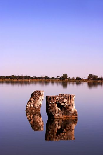 A calmness presides over Lake Bonney at Barmera in the riverland of South Australia Australian Landscape Calm Calmness Travel Photography Beauty In Nature Blue Clear Sky Copy Space Day Idyllic Lake Nature No People Non-urban Scene Reflection Rock Scenics - Nature Sky Solid Tourist Destination Tranquil Scene Tranquility Travel Destination Water Waterfront