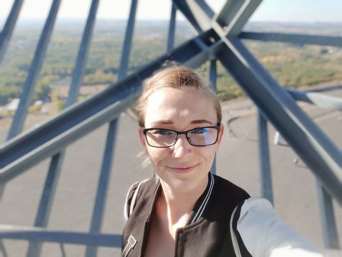 Portrait of smiling woman standing at observation point