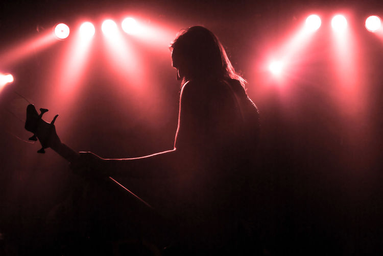 Low angle view of musician performing at nightclub